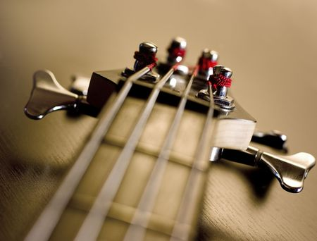 bass guitar: Machine heads for tuning guitar. Close-up. Hi-res.