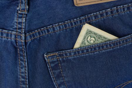 five dollars: five dollars in blue jeans pocket Stock Photo