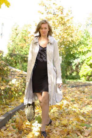 female in coat in fall