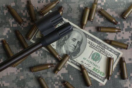 rifle, money and shells photo