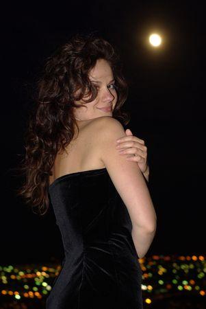 velvet dress: girl in a black velvet dress under full moon