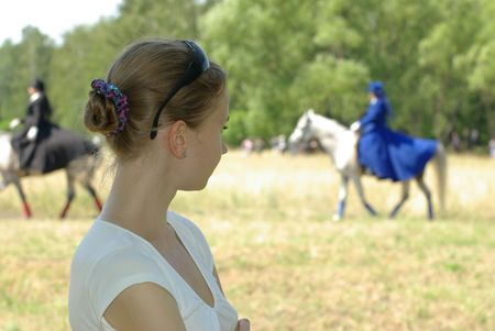 Female and a horsewoman photo