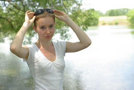 girl in a white t-shirt near the lake Stock Photo - 7343715