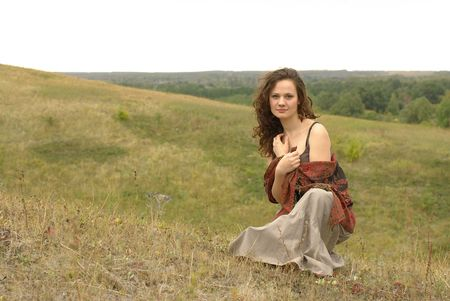 stole: Girl with a red stole sitting in the field