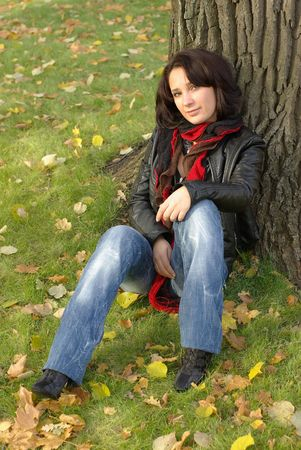 Girl sitting under the tree Stock Photo - 8156470