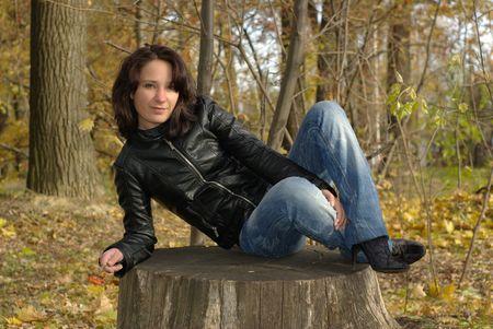 Girl sitting on a stump