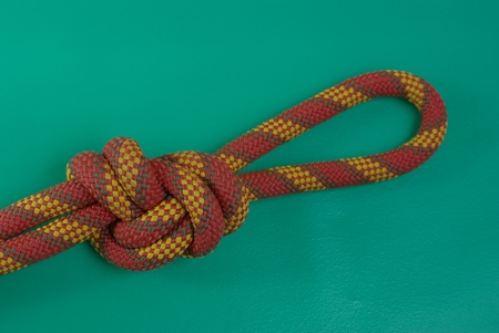 Colourful knot on the green background photo
