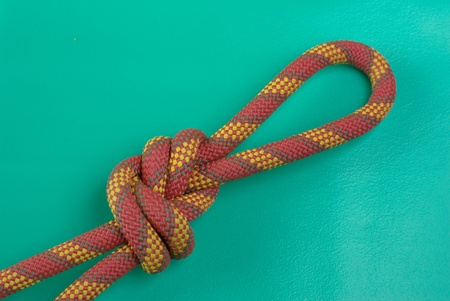 Climbing rope with knot on green Stock Photo - 8778569