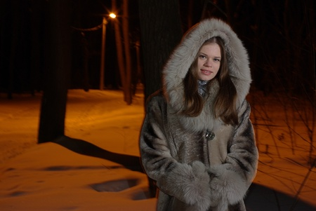 fur tree: Young female walking in a winter forest