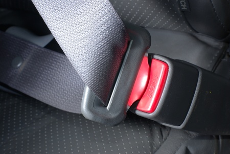 Car seatbelt on the grey background photo
