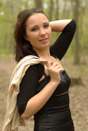 Girl holding an overcoat over her shoulder Stock Photo