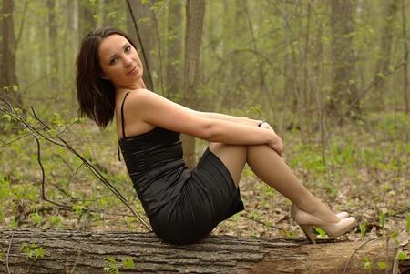 Girl in a little black dress Stock Photo