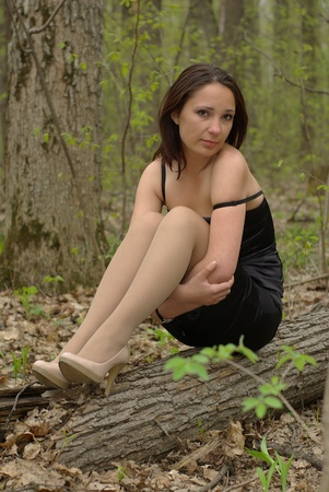 Loneliness girl in forest Stock Photo - 9897034