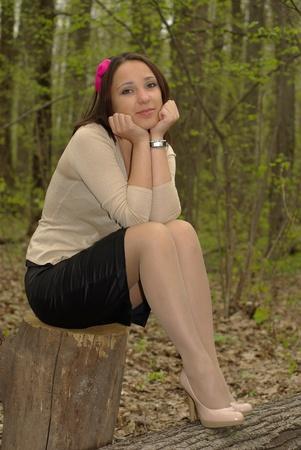 Girl on stump photo
