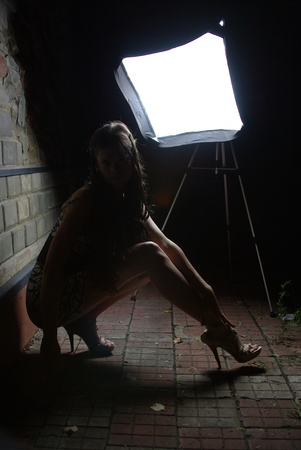 Girl in night with a softbox photo