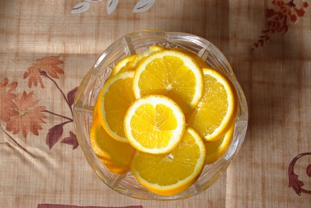Juicy orange slices in a glass bowl