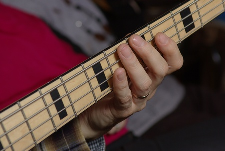 Man playing in a bass guitar photo