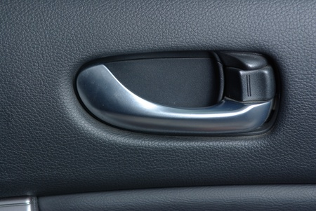 Car door handle on the leather panel Stock Photo - 12104191