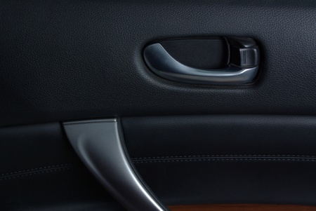 Car door handle on the leather panel Stock Photo - 12031007