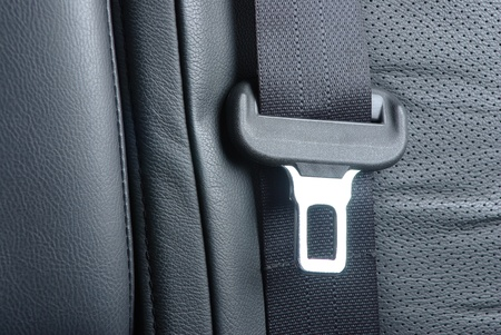 Car seatbelt on the black leather