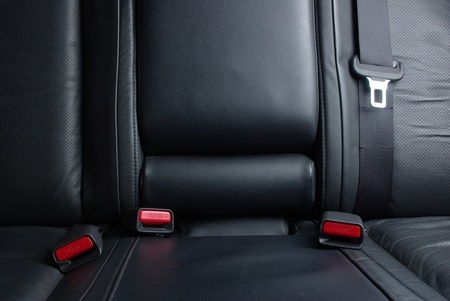 Safety buckle on the black seat in a car Stock Photo