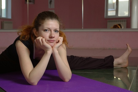 Meditating female doing yoga in the gym Stock Photo - 12328177