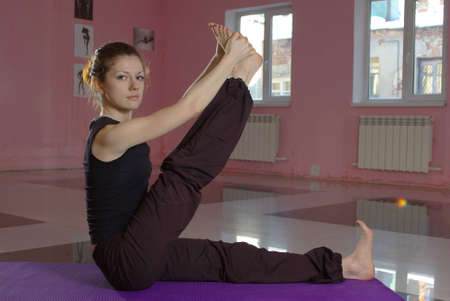 Female doing yoga in the gym photo