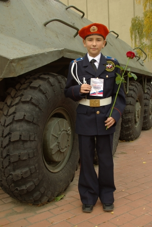 cadet blue: Young cadet with an armored troop carrier