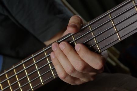 Man playing an bass guitar photo