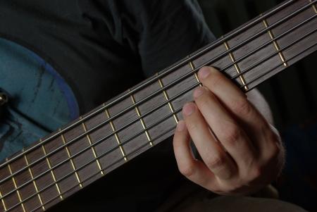 Playing an guitar photo