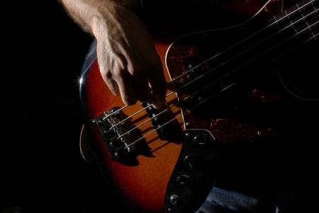 bassist: Playing an fletless bass guitar Stock Photo