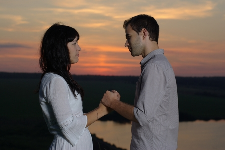 sweethearts: Sweethearts at sunset and lake Stock Photo