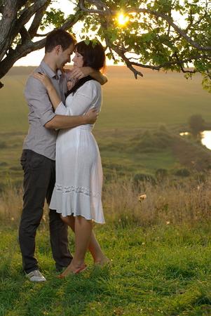 Couple under tree Stock Photo