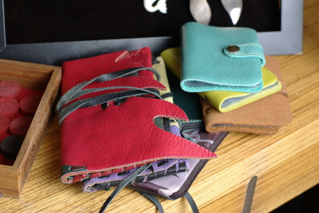 Leather wallets on wooden table