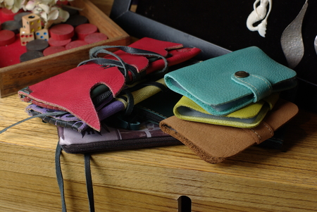 Wallets on wooden table Stock Photo