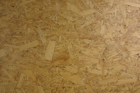 Panel from compressed wood chips and resin