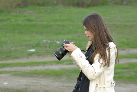Female making a photo with professional camera Stock Photo