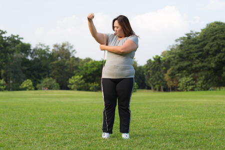 obese women: obese women is worrying about her overweight