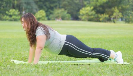 push ups: obese women push ups on grass