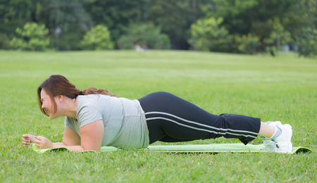 obese women: obese women planking on grass