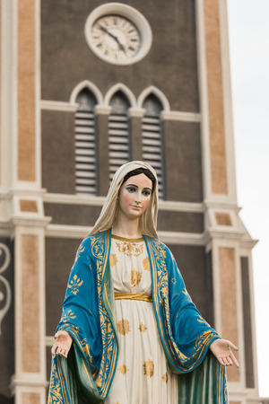 blessed virgin mary: Saint Mary or the Blessed Virgin Mary, the mother of Jesus, in front of the Roman Catholic Diocese or Cathedral of the Immaculate Conception, Chanthaburi, Thailand. Stock Photo