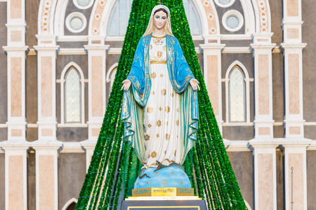 Saint Mary or the Blessed Virgin Mary, the mother of Jesus, in front of the Roman Catholic Diocese or Cathedral of the Immaculate Conception, Chanthaburi, Thailand. Stock Photo