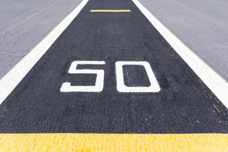 metre: Fifty metre sign on the road.