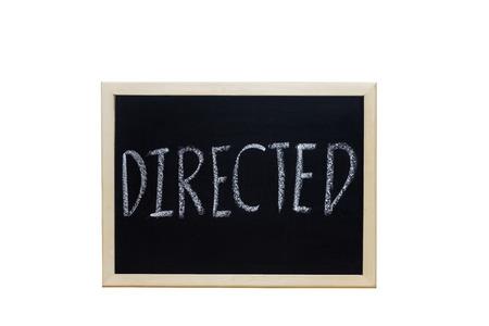 ead: DIRECTED written with white chalk on blackboard.