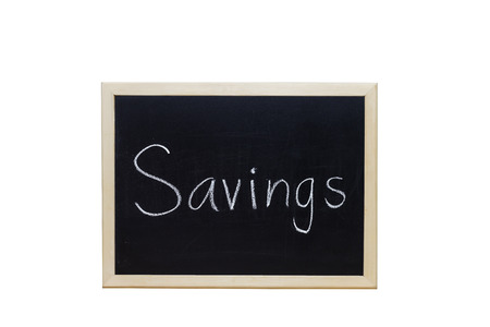 thrifty: Savings written with white chalk on blackboard.