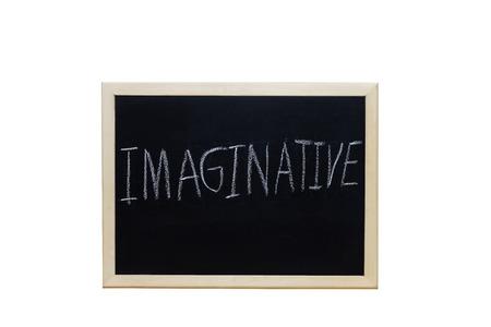 envisage: IMAGINATIVE written with white chalk on blackboard.