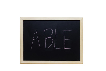 able: ABLE written with white chalk on blackboard.