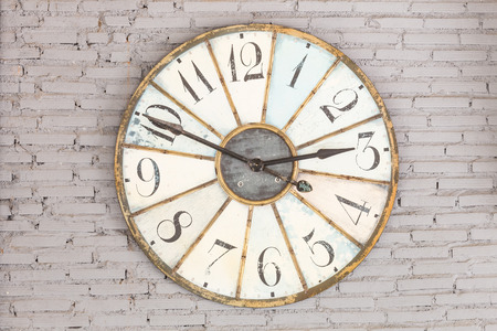 face to face: Retro clock on the wall Stock Photo