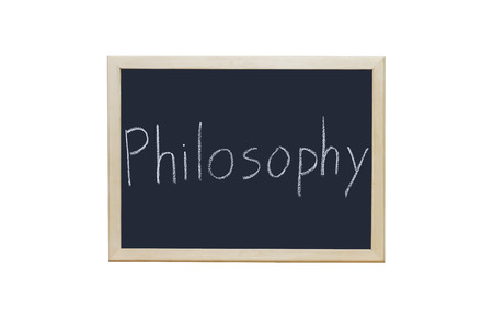 philosophy: Philosophy written with white chalk on blackboard. Stock Photo