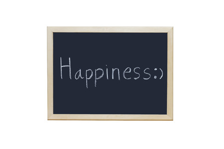 elysium: Happiness written with white chalk on blackboard. Stock Photo